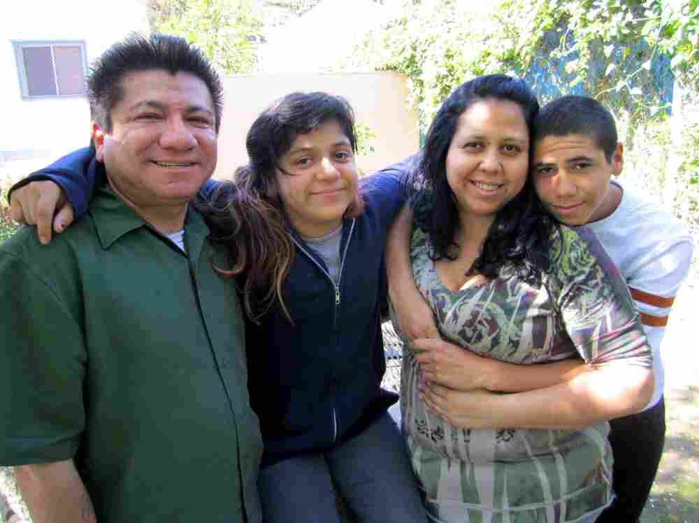 April Casanova-Rios (second from right) visits the school health center at Abraham Lincoln High School in Los Angeles with her family. Her son, Isaiah Casanova (to her right), is a sophomore at the school.