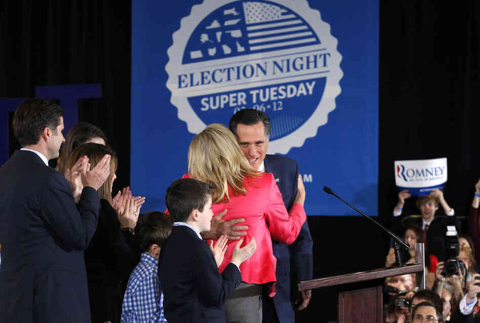 Mitt Romney hugs his wife, Ann, as he arrived at his Super Tuesday rally in Boston. Romney narrowly beat Santorum in Ohio.