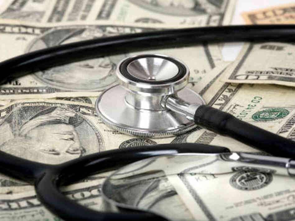 money; stethoscope
