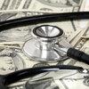 money; stethoscope