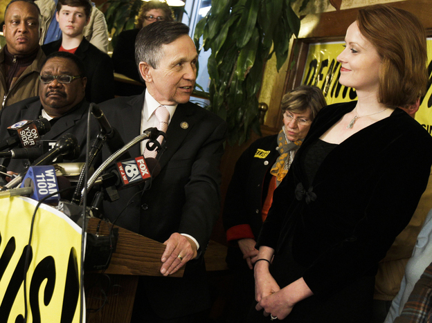 Rep. Dennis Kucinich, D-Ohio, thanks his wife, Elizabeth, while conceding defeat in his race against Rep. Marcy Kaptur at Rubin's Restaurant and Deli in Cleveland on Tuesday.