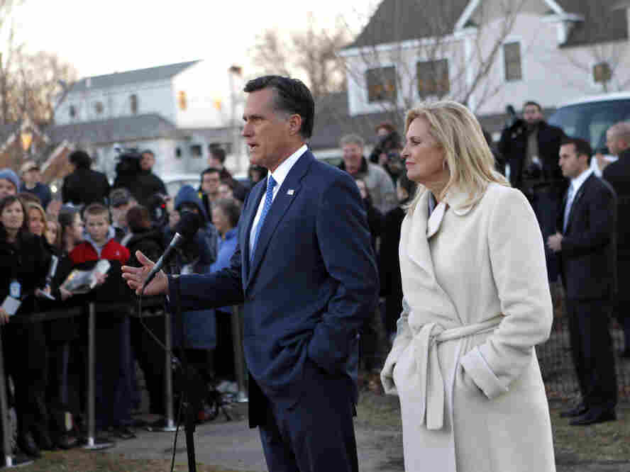 Mitt Romney, with wife Ann, talks to reporters after voting in the Massachusetts primary i
