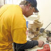 Robby Richardson crafts handmade stirrups for Nettles Country in Madisonville, Texas. The company would like to hire more workers, but can't afford to.