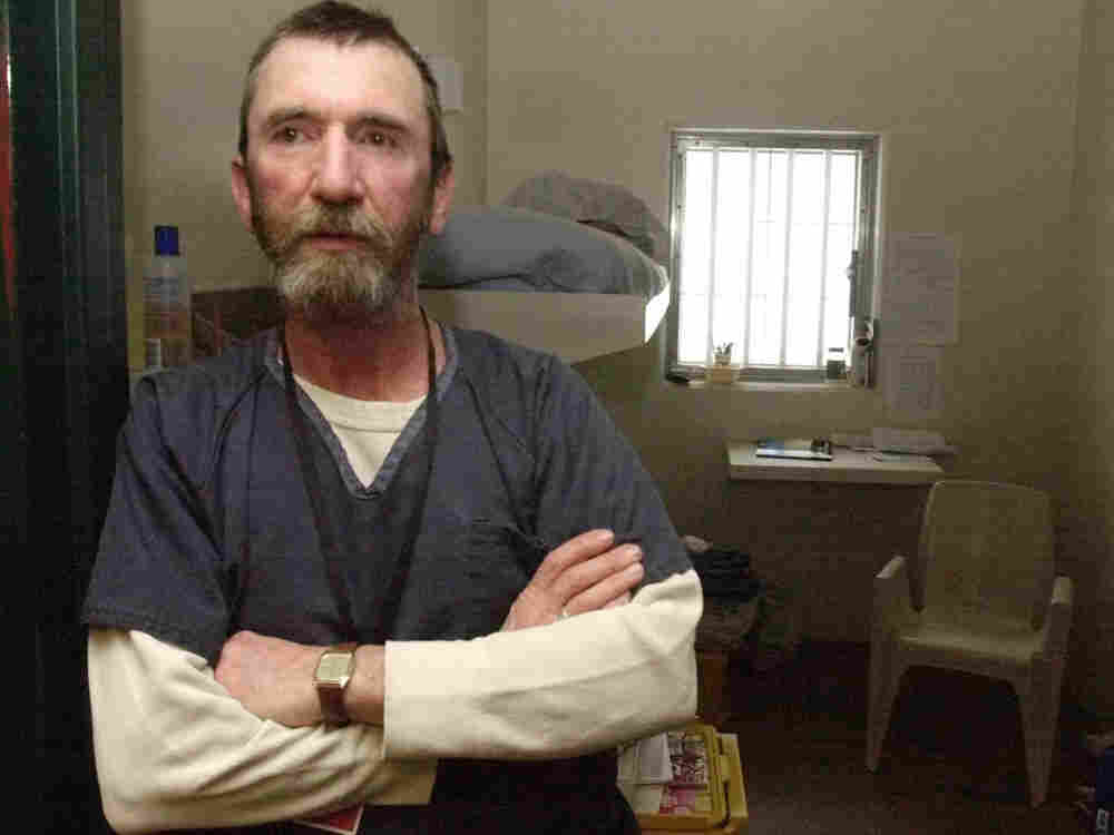George Ladabouche stands at the entrance to his cell at the state prison in Newport, Vt., March 5, 2003.