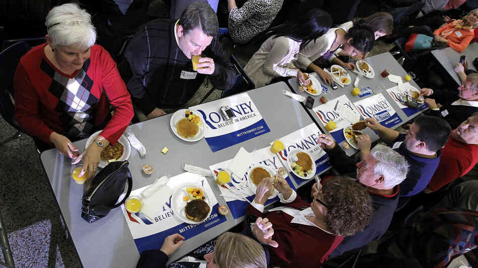 Mitt Romney supporters share a pancake brunch in Snellville, Ga., on Sunday. Rival Newt Gingrich won the state on Super Tuesday, by about 22 percentage points.