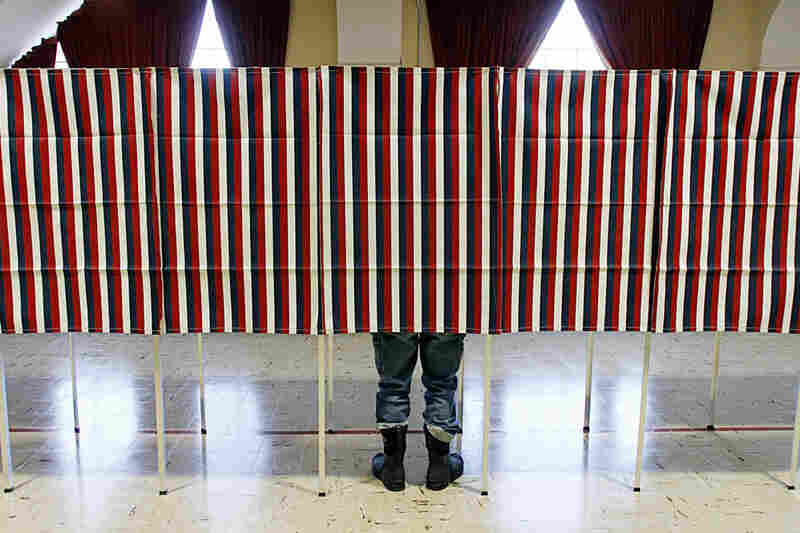 A voter casts his ballot in Montpelier, Vt. Romney is also expected to do well in the state, which borders Massachusetts.