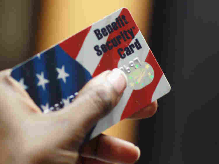 One USDA official credits the use of plastic benefit cards with helping to reduce federal food stamp fraud. But lawmakers say that isn't enough.