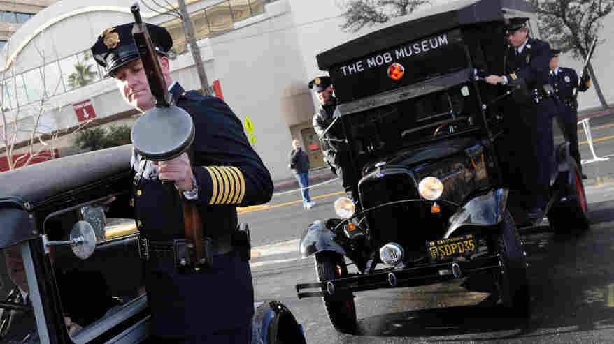 Look Out, Copper: A 1928 Ford Model A car (left) and a 1938 Ford paddy wagon arrive at the Feb. 14 grand opening of The Mob Museum in Las Vegas.