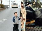 Yuko Sugimoto (right) stands reunited with her 5-year-old son, Raito, on a road in Japan's Miyagi prefecture, 2012. This photo was taken at the same place where she was photographed immediately after the tsunami in March 2011.