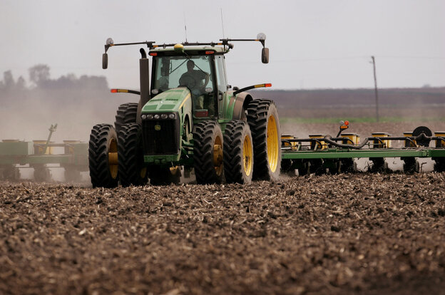 Planting corn with a tractor in 2007 near Rochelle, Illinois.