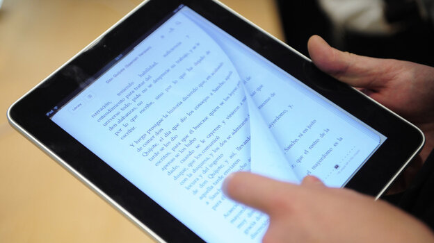 A customer reads a book an iPad.