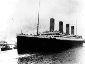 The liner Titanic leaves Southampton, England, on her maiden voyage in 1912. Five days into her journey, the ship struck an iceberg and sank. A new map covers the field of debris for the first time.