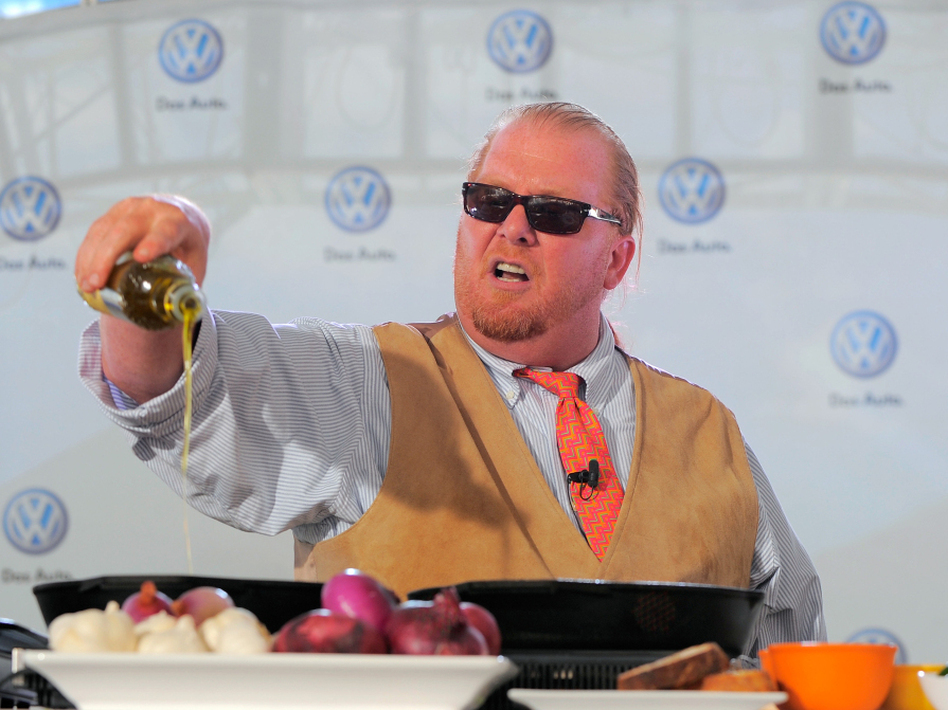 Chef Mario Batali prepares dishes for the crowd at the world premiere of Volkswagen's new Jetta compact sedan in New York City in 2010. (Jemal Countess/Getty Images)