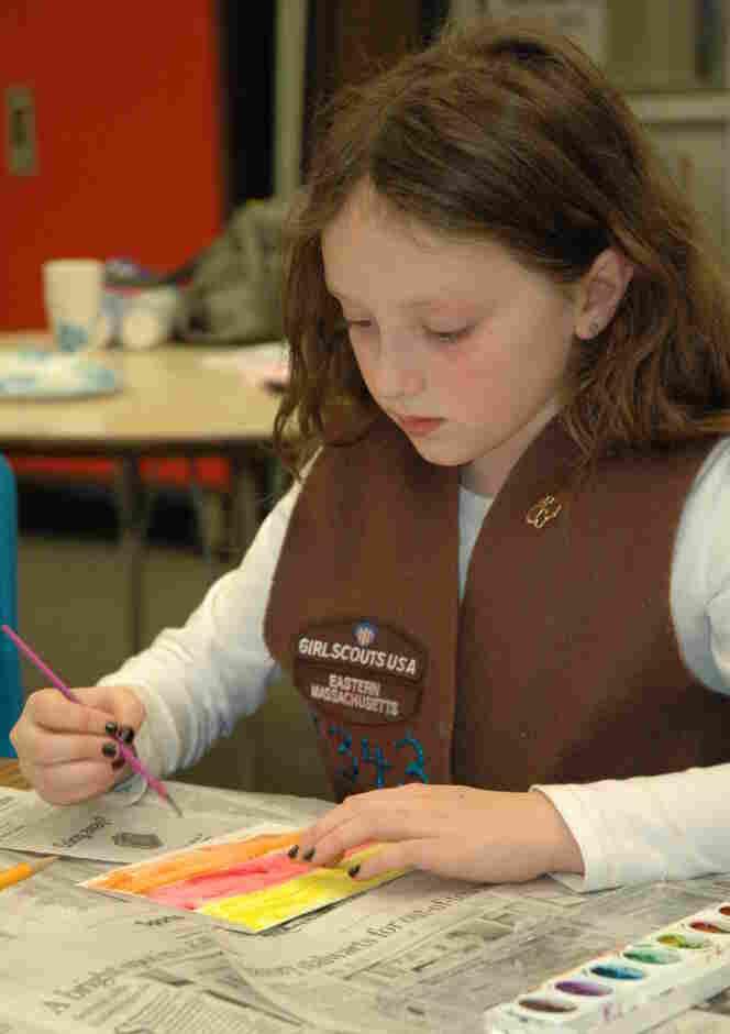 A member of Brownie Troop 65343 works on an art project at a troop meeting.