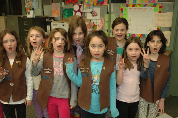 Brownies from Troop 65343 in Brookline, Mass. recite the Girl Scout pledge. Enrollment in the organization has declined since the 1980s, but a modernizing makeover and