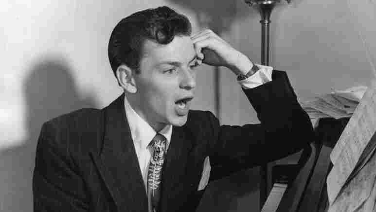 Frank Sinatra at the piano.