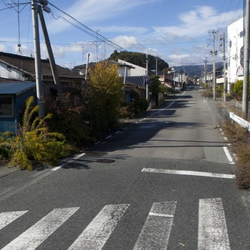 A deserted street inside the contaminated exclusion zone around the crippled Fukushima Dai-ichi nuclear power station, on Nov. 12, 2011. Experts say health effects of radiation exposure likely won't be detectable and a bigger problem is the mental health issues resulting from the trauma of the tsunami.