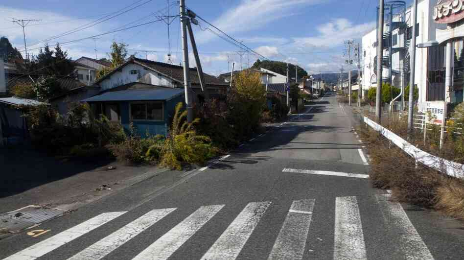 A deserted street inside the contaminated exclusion zone around the crippled Fukushima Dai-ichi nuclear power station, on Nov. 12, 2011. Experts say health effec
