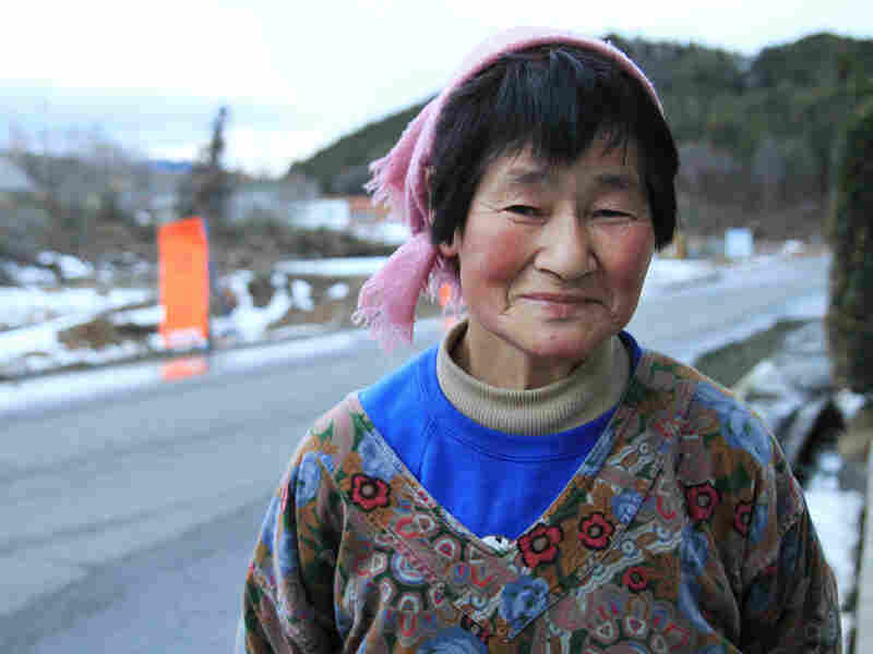 Yoshiko Watanabe stands near where her roadside vegetable stand used to be in Kawauchi village in Japan's Fukushima prefecture.