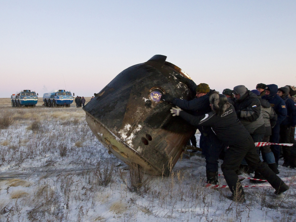 Russia's space agency ground personnel check a Soyuz TMA-02 capsule after its landing near the town of Arkalyk in northern Kazakhstan, on Nov. 22, 2011. The next Soyuz launch, to send a relief crew to the International Space Station, is scheduled for May 15. (AFP/Getty Images)