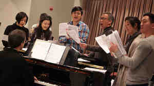 Prepping for a New York City Shinsai benefit, actors Angel Desai (left), Olivia Oguma, Paolo Montalban, Thom Sesma, Cindy Cheung and Johnny Wu rehearse songs from Pacific Overtures in a Lincoln Center studio.