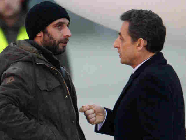 French photographer William Daniels (left) speaks with France's President Nicolas Sarkozy at a military airport outside Paris on March 2, just after escaping from Syria via Lebanon.