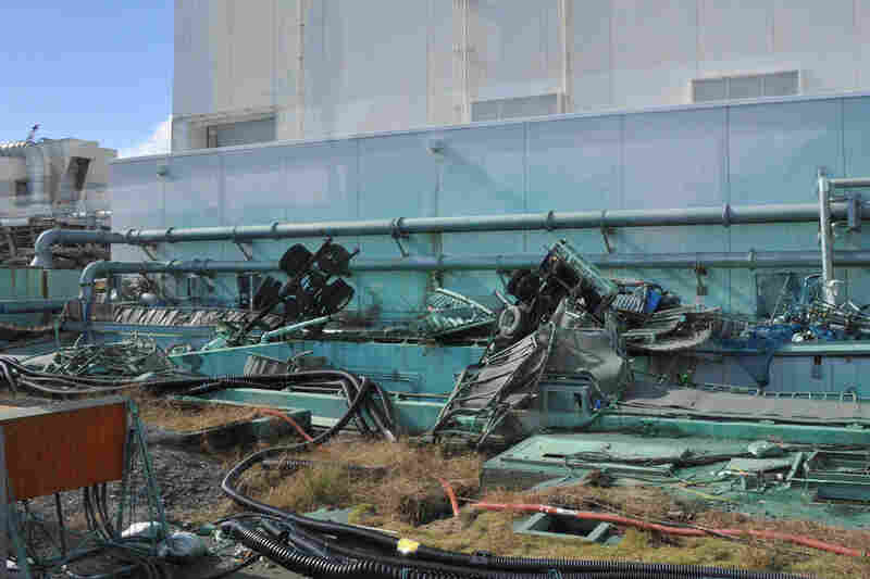 Broken vehicles remain abandoned near a turbine building for months after the water receded. Rubble was virtually untouched before this Nov. 12 photo was taken.