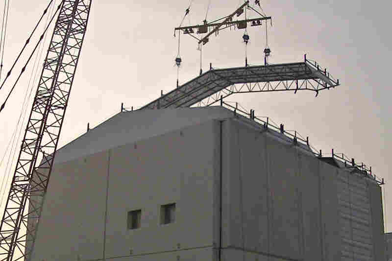 A huge iron tent is constructed over one of the reactor buildings at the facility in October. Cleanup efforts could continue for decades.