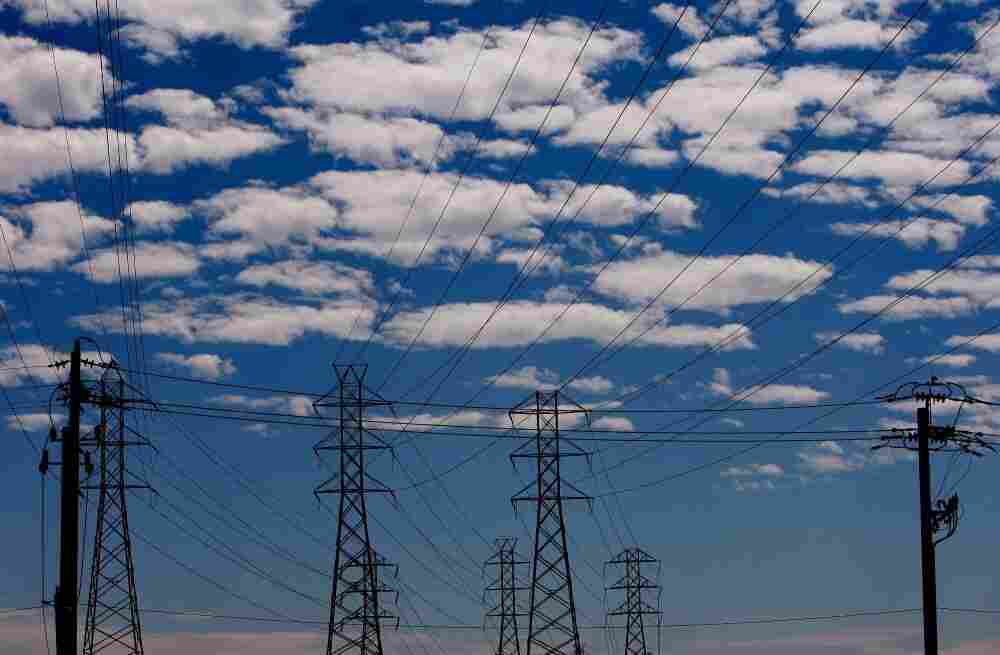 Towers carry electrical lines in San Francisco. The electricity grid is a web of power stations, transformers and transmission lines that span the continent.