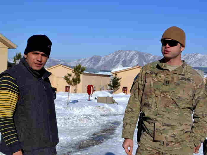 Army Capt. Joe Fritze (right), who trains Afghan police officers in Kabul, works closely with interpreter Gul Agha Shirazi. Fritze says he depends on Shirazi not just to translate, but to warn him if he senses anything suspicious or dangerous.