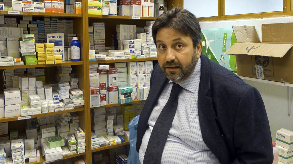Nikitas Kanakis, director of the Greek branch of Doctors of the World, says people are desperate for food and medicine. He says that the medicines at the clinic his group runs in Perama are all donated.  (Landov/MCT)