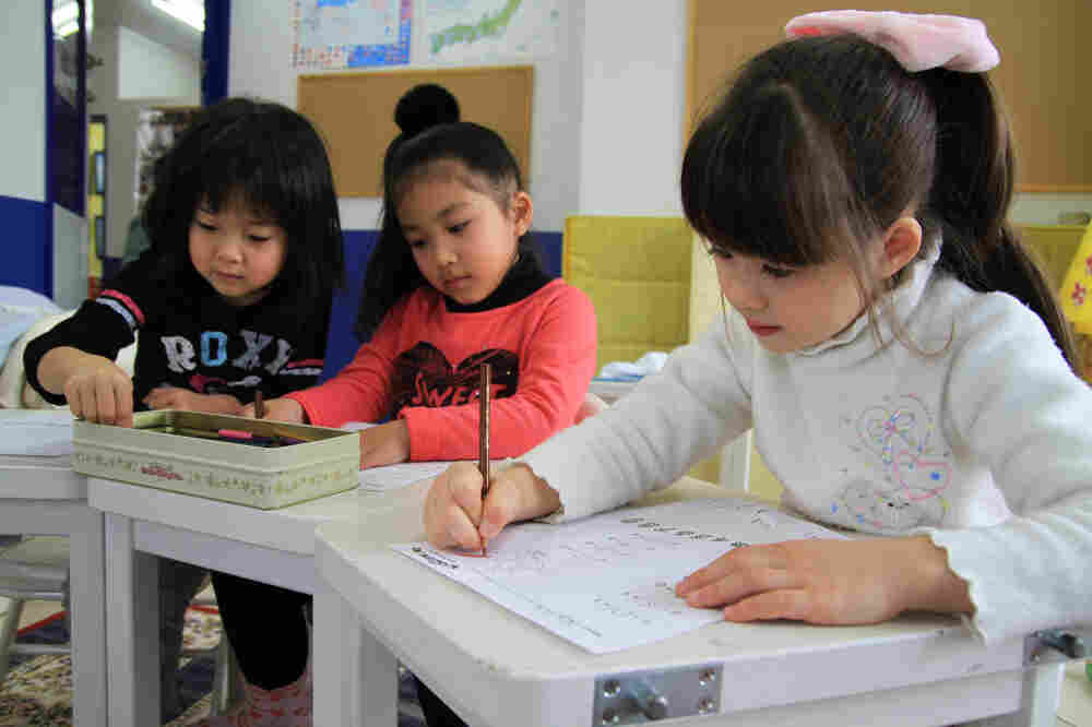Students draw during art class at Imagine Japan, an English-language school in Sendai City, Japan. Immediately following last year's earthquake and tsunami in northeast Japan, a teacher observed some of the kids drawing faces and bodies with black markers.