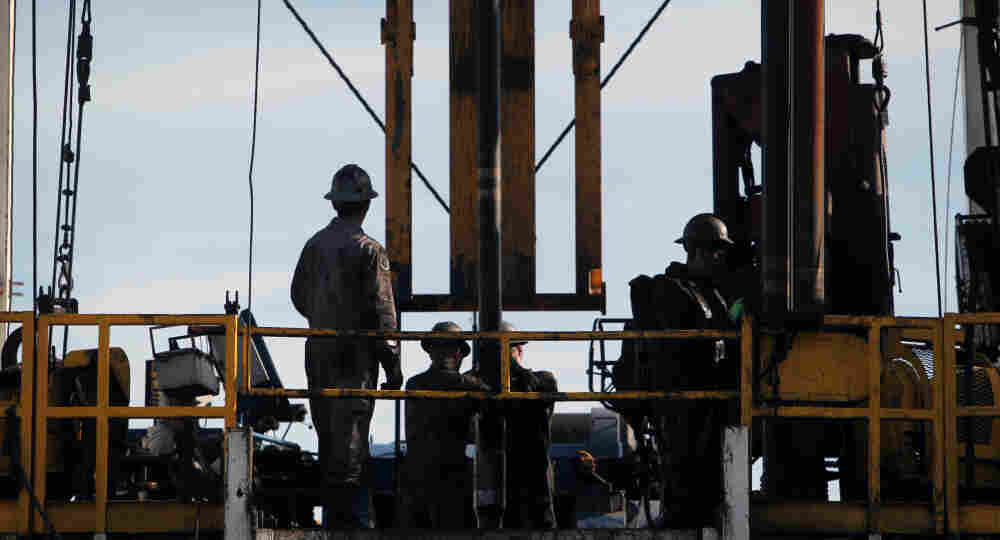 Oil workers on a drilling rig owned by Chesapeake Energy in Ohio. Students are flocking to the energy field.