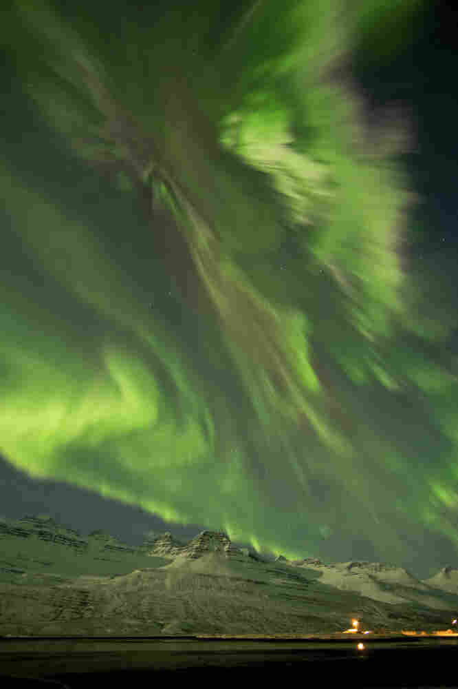 The Northern Lights in the sky Thursday above Faskusfjordur on the east coast of Iceland Thursday.