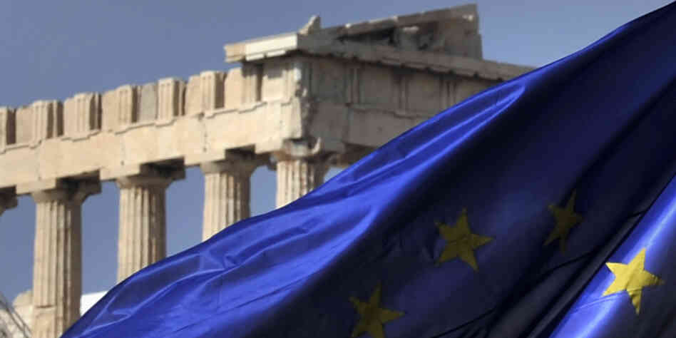 The European Union flag flies in front of the Parthenon in Athens. Greece's EU partners are about to give