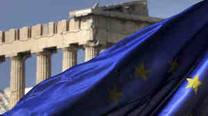 The European Union flag flies in front of the Parthenon in Athens. Greece's EU partners are about to give it another massive bailout.
