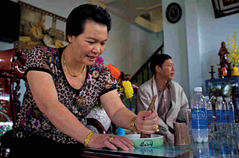 A woman grinds a piece of rhino horn in a Vietnamese cafe. By adding a little water and rubbing the horn over the dish's sandpaper-like bottom, she creates a solution that many Asians believe is a super-vitamin and a cure for various maladies. Few scientific studies have been conducted on rhino horn's medicinal benefits, and the results have been inconclusive.