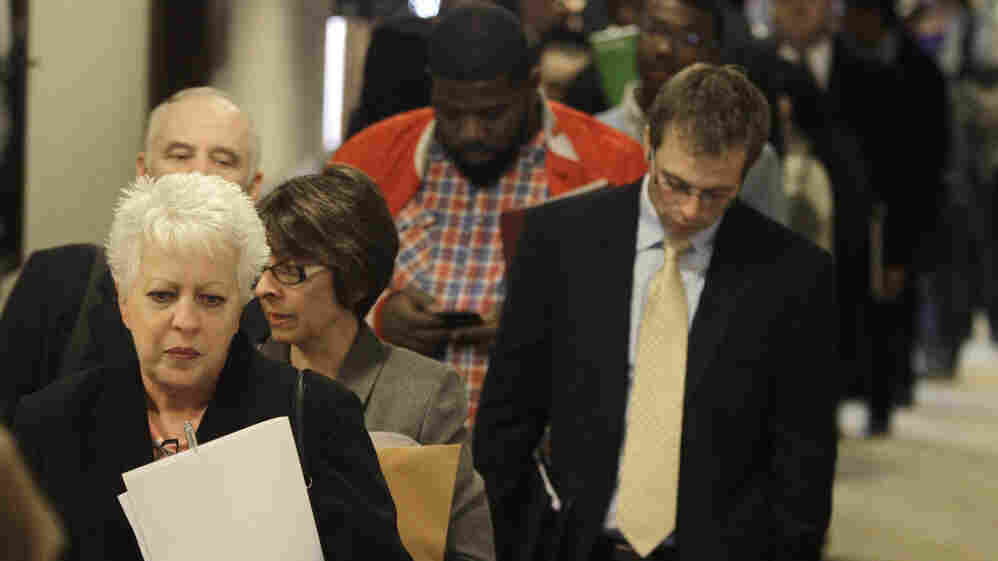 People wait in line to get into a job fair in Independence, Ohio, in November.