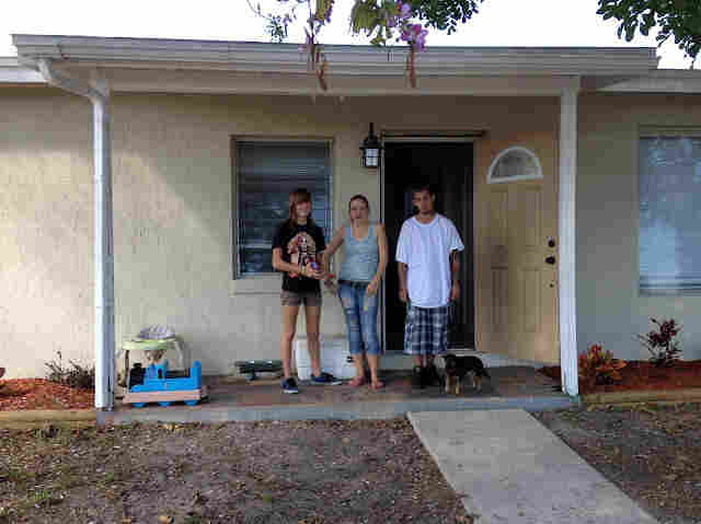 Willow and her tenants, in front of the house Willow bought with her mother.