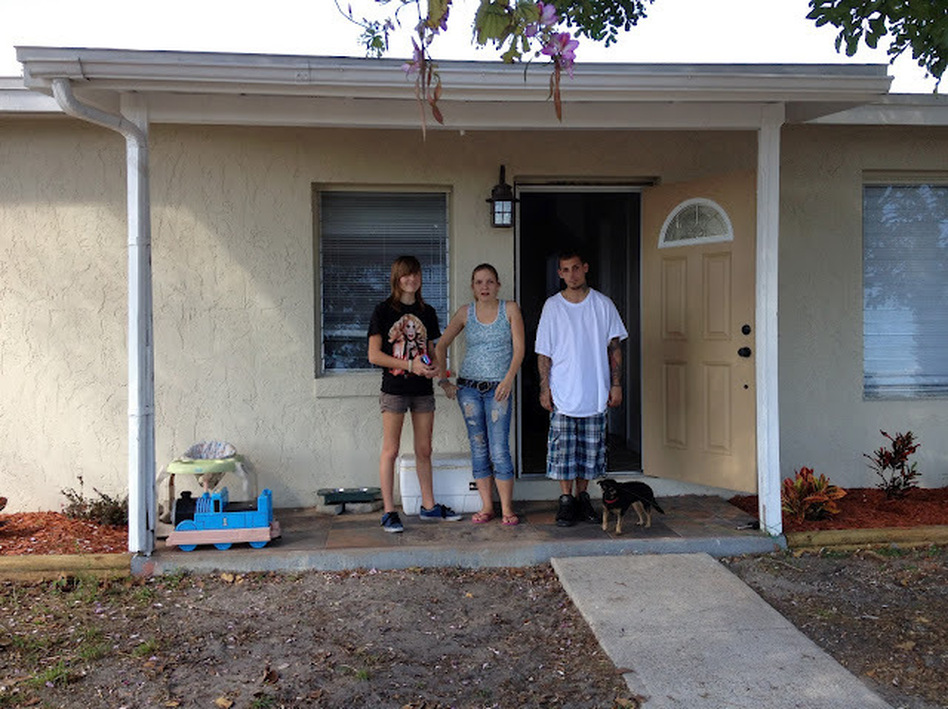 Willow and her tenants, in front of the house Willow bought with her mother. (NPR)