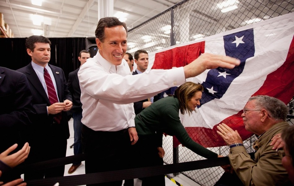 Former Pennsylvania Sen. Rick Santorum and his wife, Karen, greet supporters during a rally Saturday in Springfield, Mo. After picking up a decisive win in Kansas, Santorum now turns his attention to Missouri's upcoming caucuses.