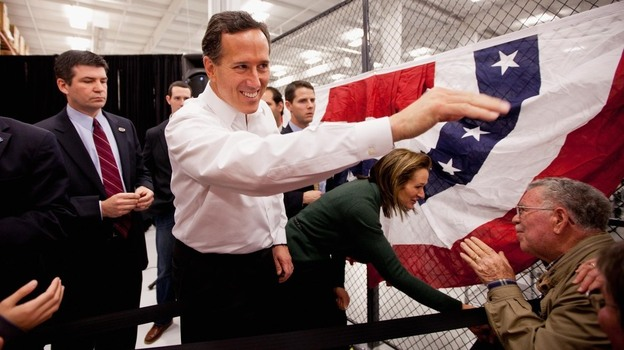 Former Pennsylvania Sen. Rick Santorum and his wife, Karen, greet supporters during a rally Saturday in Springfield, Mo. After picking up a decisive win in Kansas, Santorum now turns his attention to Missouri's upcoming caucuses. (Getty Images)
