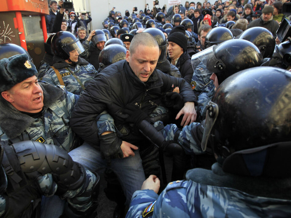 Police officers detain opposition leader Sergei Udaltsov after the rally Saturday.  (AP)