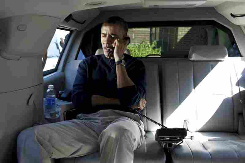 President  Obama talks on the phone with Afghanistan President Hamid Karzai from his vehicle outside a community center in Chevy Chase, Md.