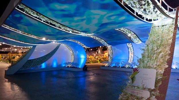 "Visitors to the 2012 Philadelphia International Flower Show entered through a wave-like tunnel. The show's theme was ""Hawaii: Islands of Aloha."""