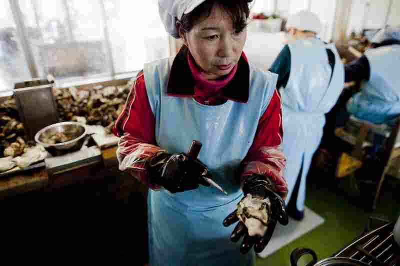 Farmer Yoshitaka Abe's wife, Yumiko, 54, works in an oyster factory.