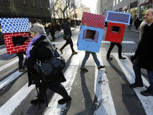 People dress as forclosed homes during a protest representing 14 million unemployed Americans and demanding action from congress and corporations on March 6, 2012 in New York. The most recent jobs report from the Bureau of Labor Statistics has shown promising results.