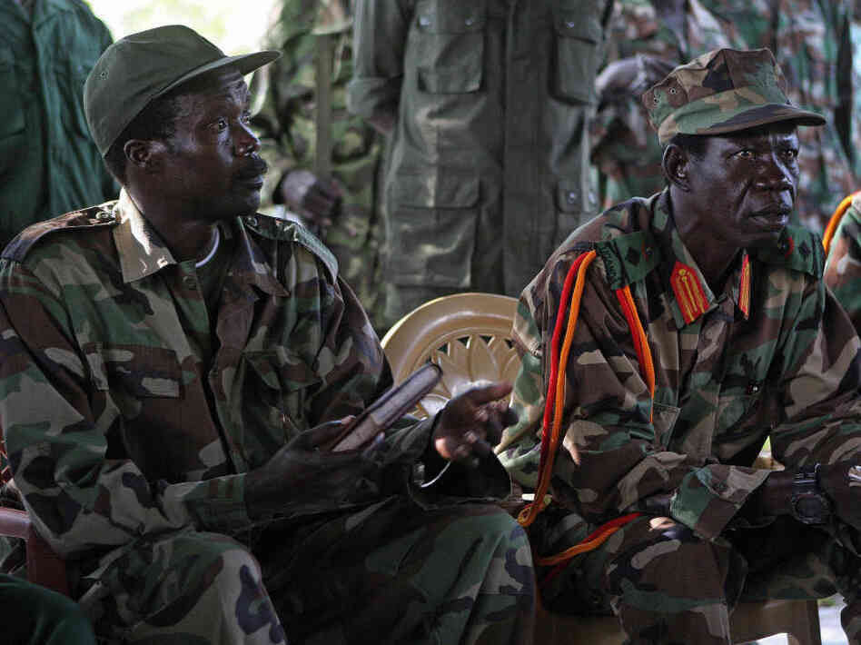 The leader of the Lord's Resistance Army, Joseph Kony (L) and his deputy Vincent Otti sit inside a tent Nov. 12, 2006 at Ri-Kwamba in Southern Sudan during a meeting with UN humanitarian chief Jan Egeland.  Kony is one of the world's most-wanted war crimes suspects.