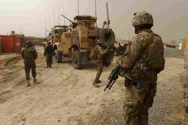U.S. soldiers keep watch at the entrance of a military base near Alkozai village.