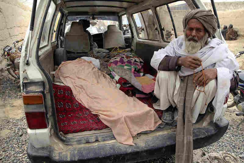 Villagers display the bodies of those allegedly killed when an American soldier opened fire on Afghan civilians.